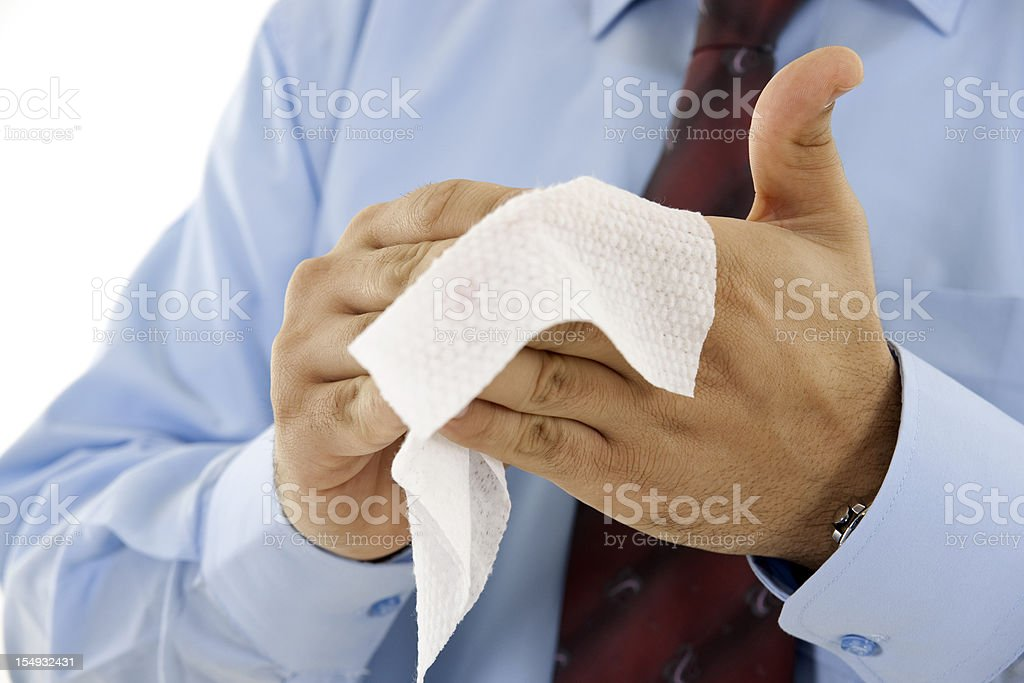 Businessman wiping hands with wet towel stock photo