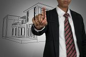Businessman with 3D wireframe architecture
