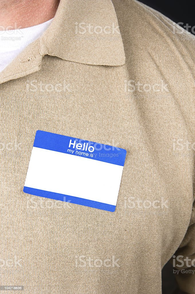 Businessman with a blank nametag stock photo