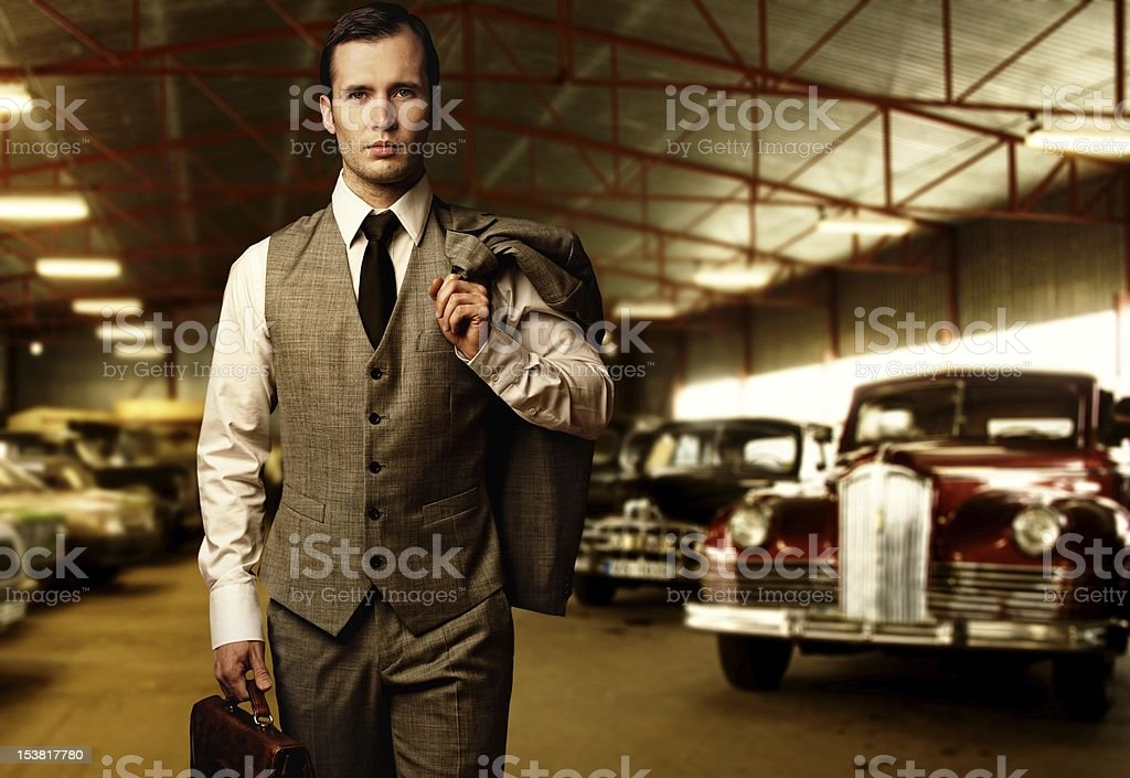 Businessman with a briefcase in garage stock photo