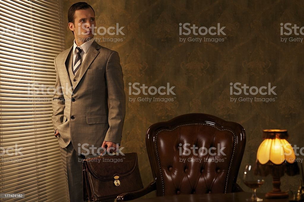 Businessman with a briefcase in retro interior stock photo