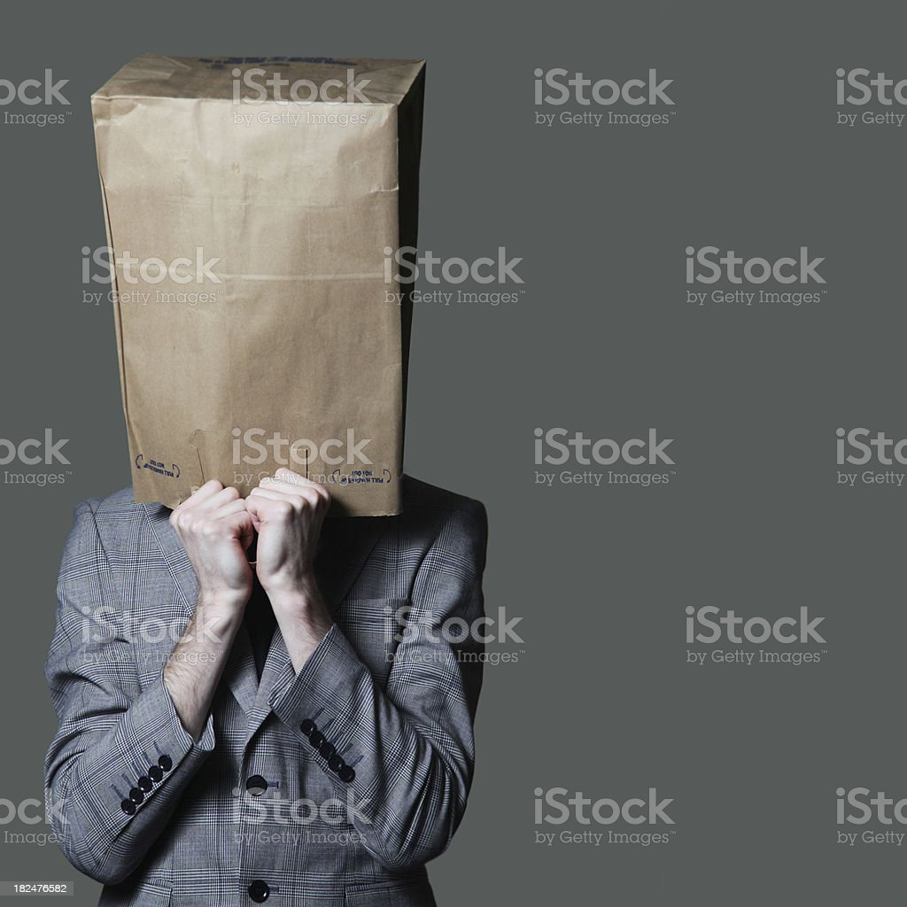 Businessman with a brown paper bag on his head stock photo