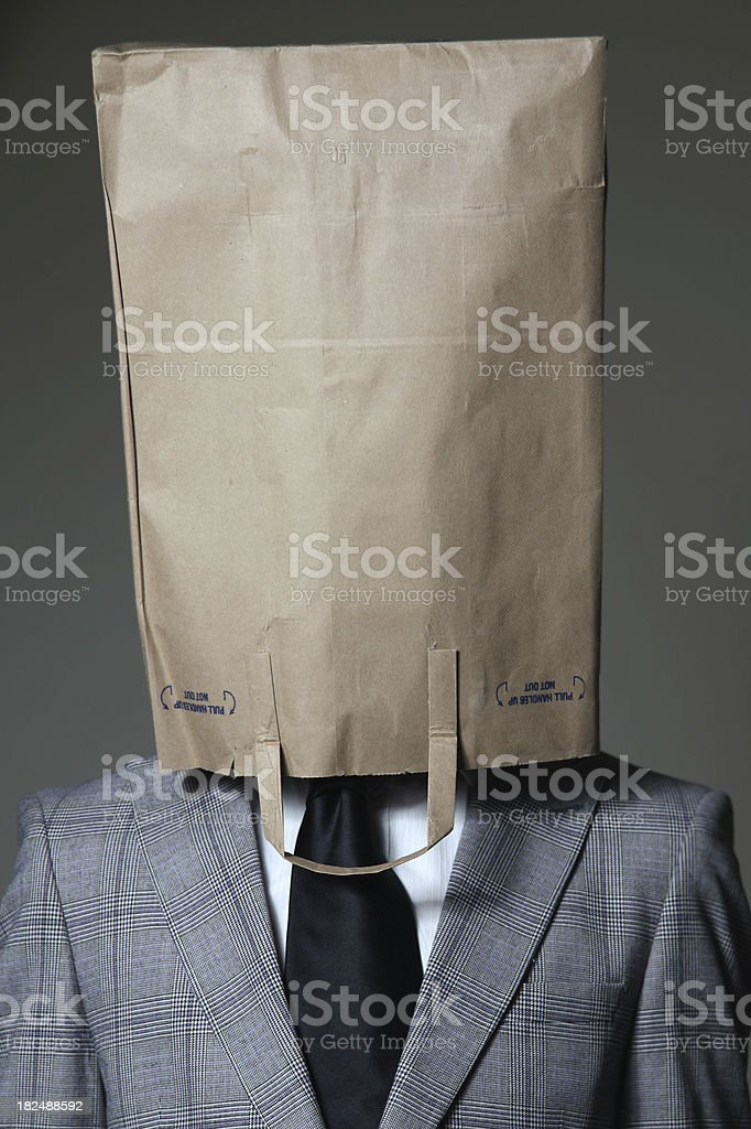 Businessman with a brown paper bag on his head royalty-free stock photo