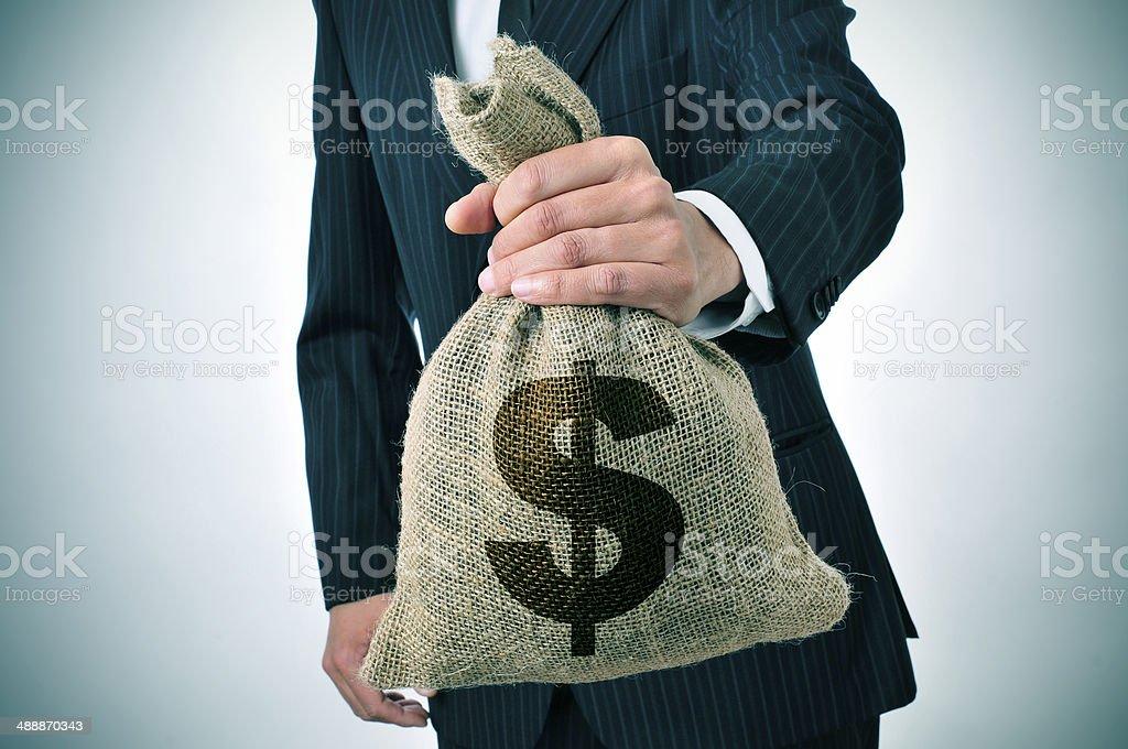 businessman with a burlap money bag stock photo