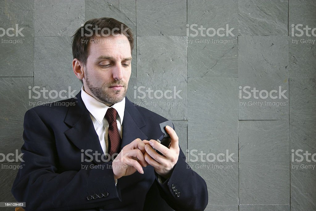 Businessman with a calculator royalty-free stock photo