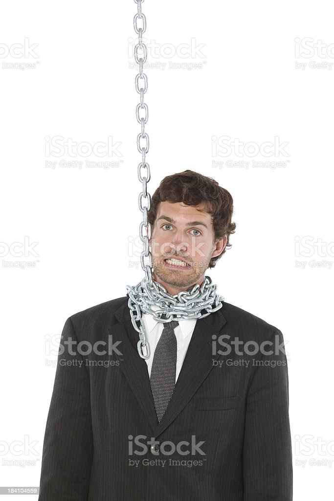 Businessman with a chain wrapped around his neck stock photo