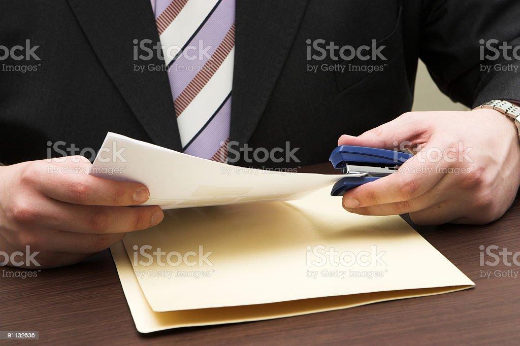 Businessman with a folder stock photo