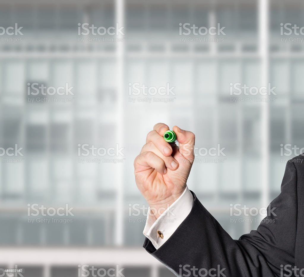 businessman, with a green pen stock photo