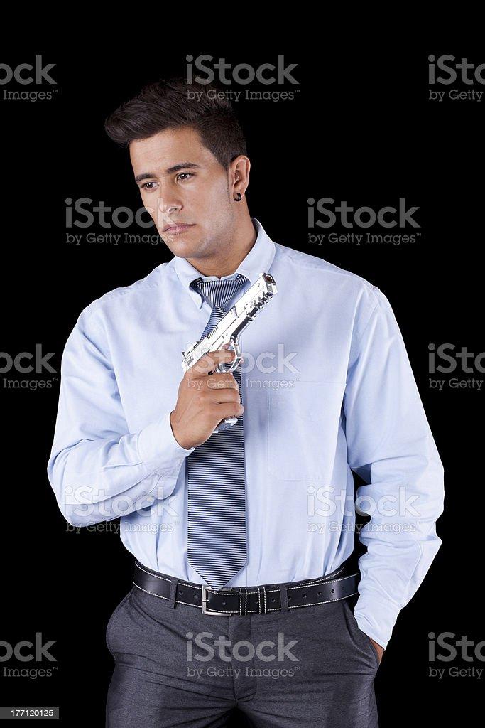 Businessman with a handgun royalty-free stock photo