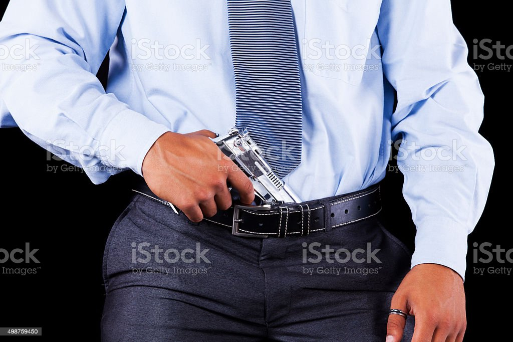 Businessman with a handgun stock photo