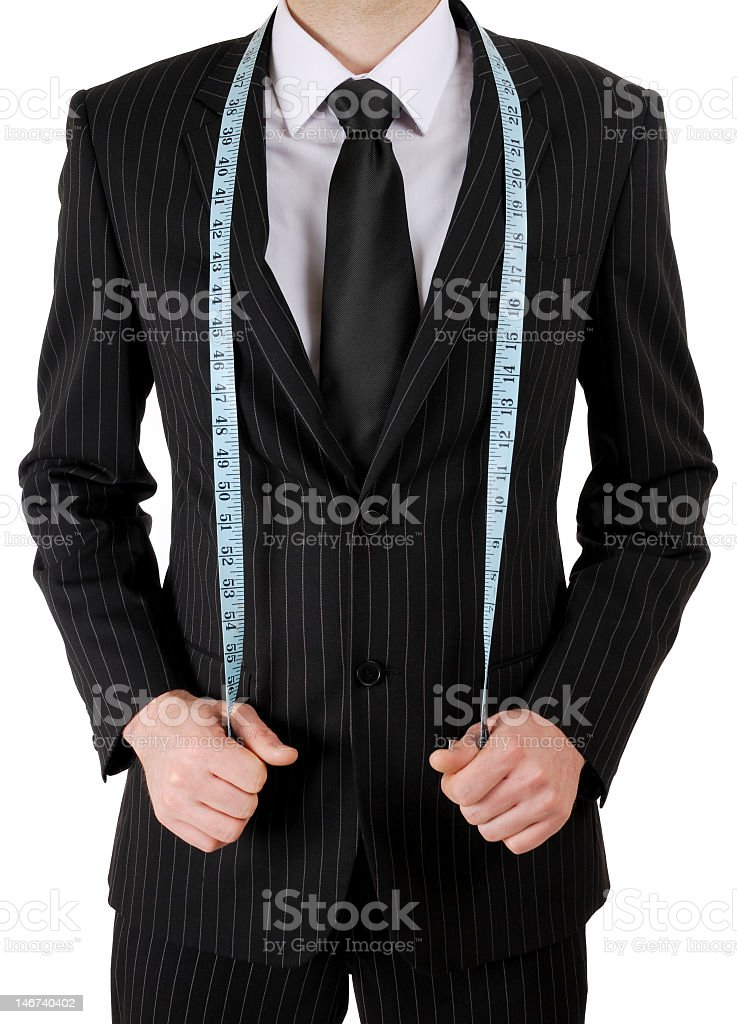 A businessman with a measuring tape around his neck stock photo