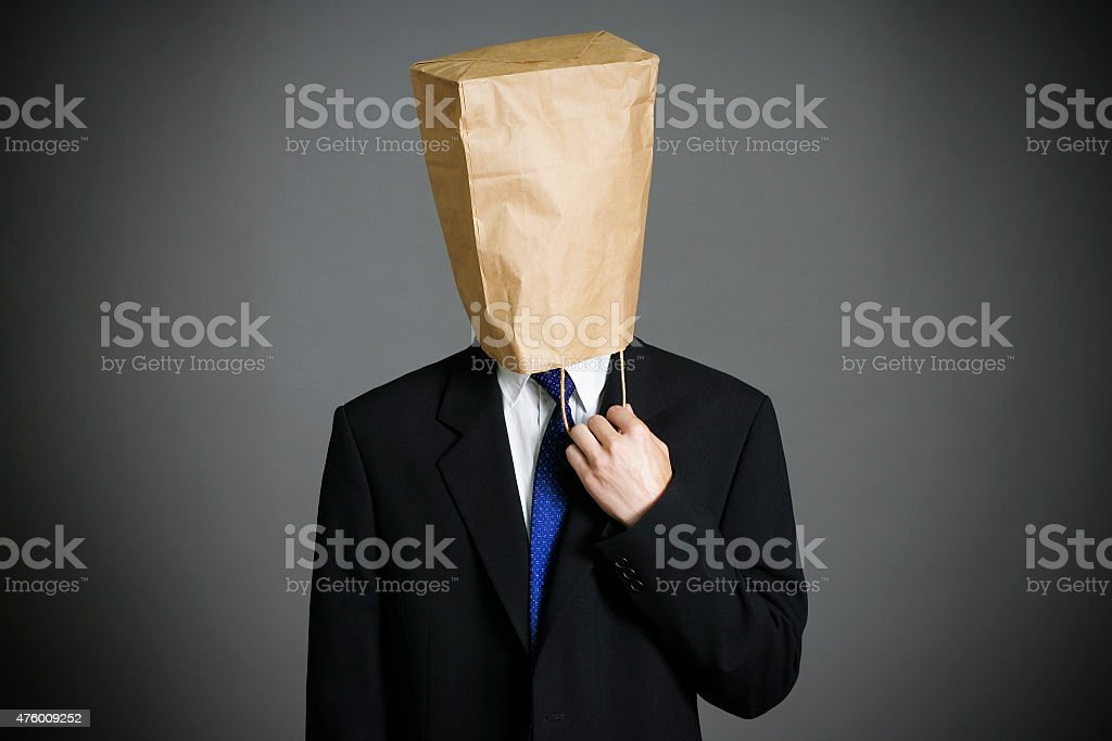 Businessman with a paper bag on head stock photo