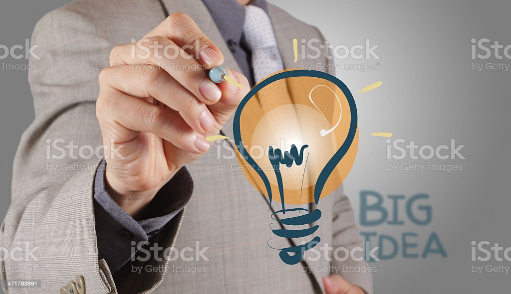 businessman with a pen drawing light bulb royalty-free stock photo