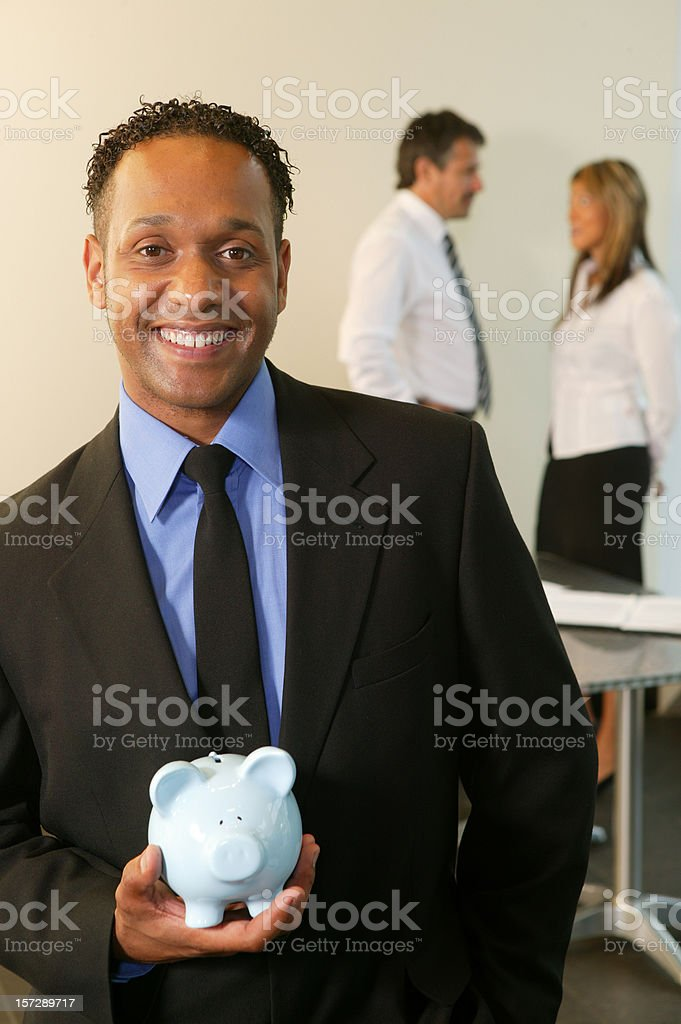 businessman with a piggy bank royalty-free stock photo