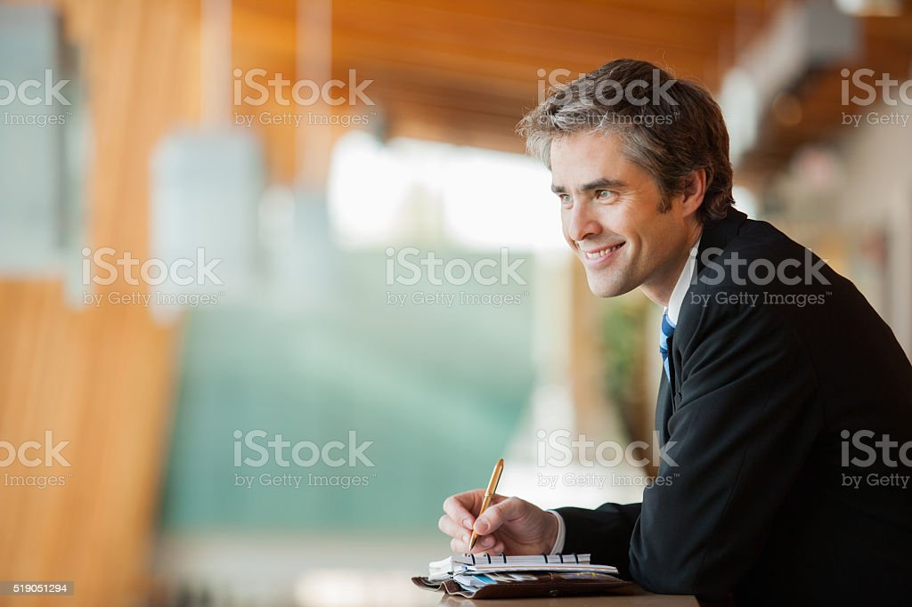 Businessman with a planner stock photo