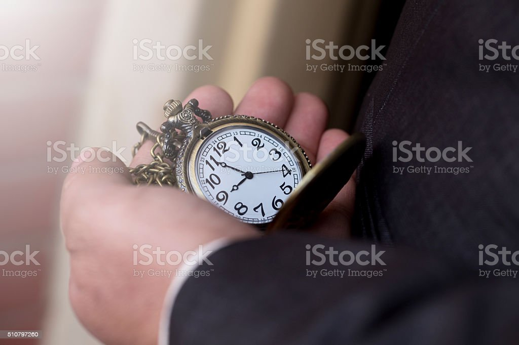 Businessman with a pocket watch in his hand stock photo