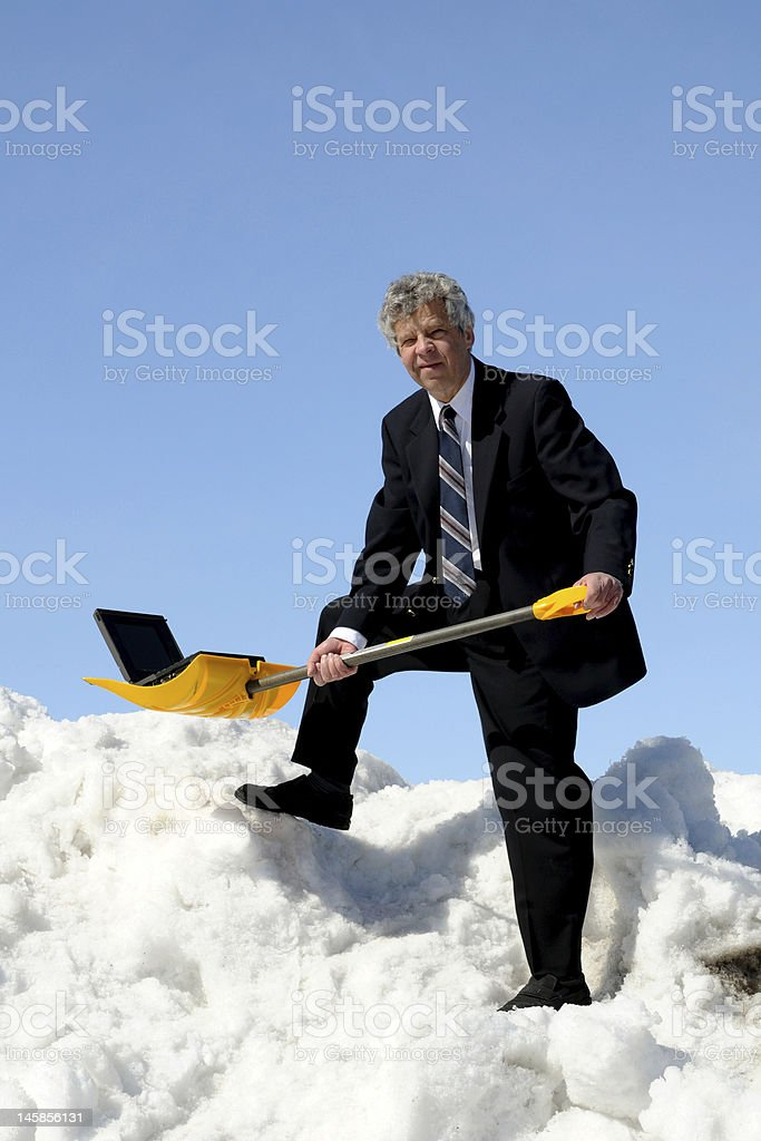 Businessman with a  shovel stock photo
