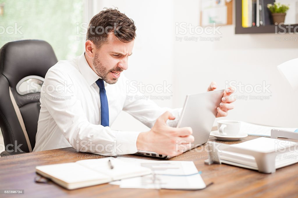 Businessman with a slow internet connection stock photo
