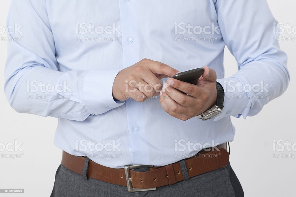 Businessman with a smartphone stock photo