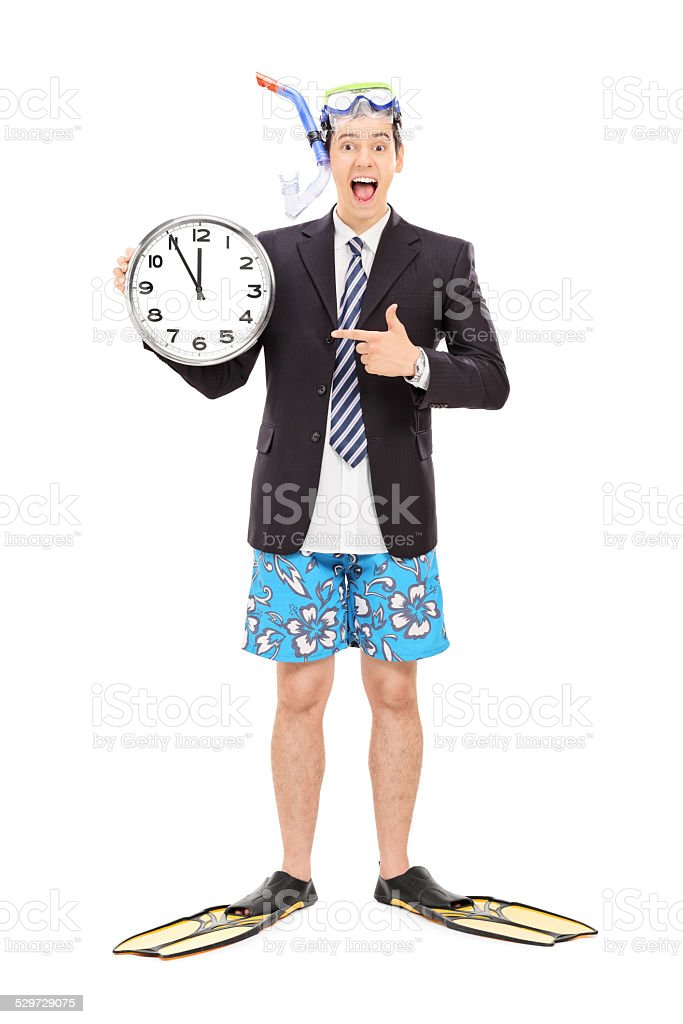 Businessman with a snorkel holding wall clock stock photo