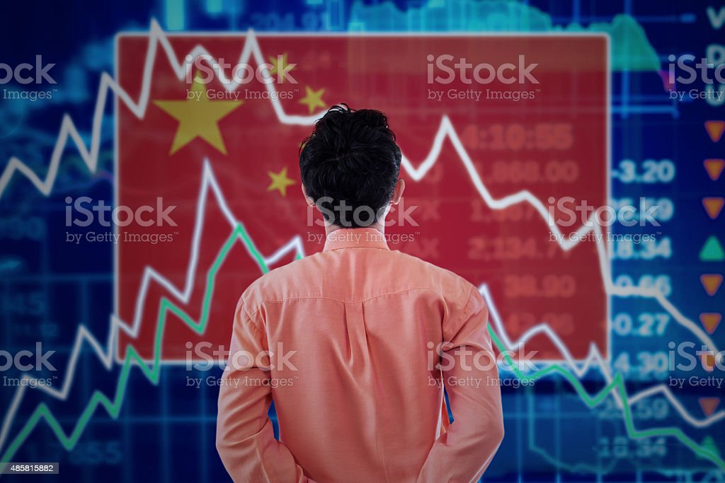 Businessman with a stock market of china stock photo