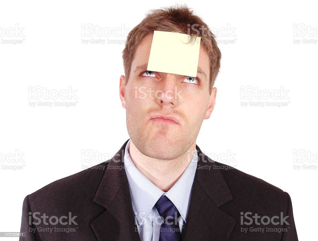 A businessman with a yellow sticky note on his forehead stock photo