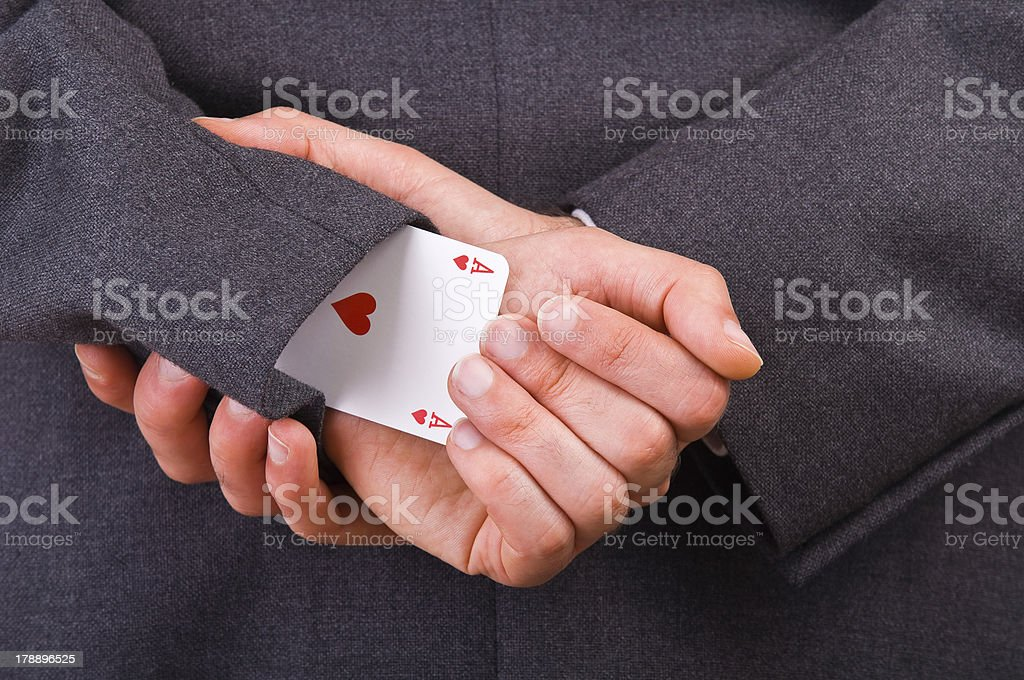 Businessman with ace card hidden under sleeve. royalty-free stock photo
