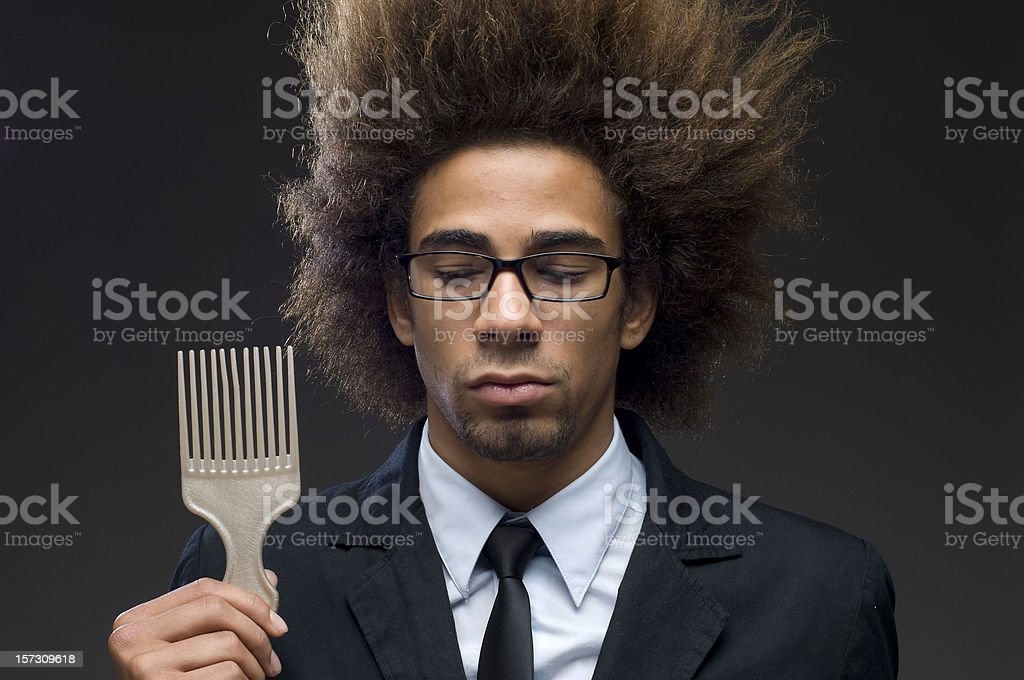businessman with afro hairstyle comb royalty-free stock photo