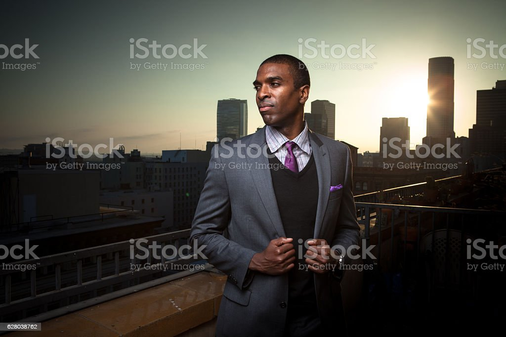 Businessman With Ambiguous Expression on Balcony stock photo