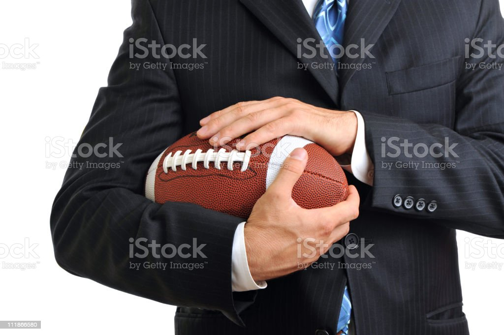 Businessman with American Football on White Cropped royalty-free stock photo