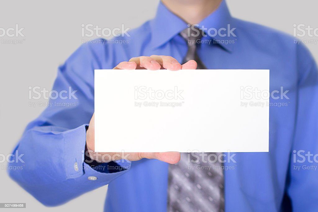 Businessman with an empty card stock photo