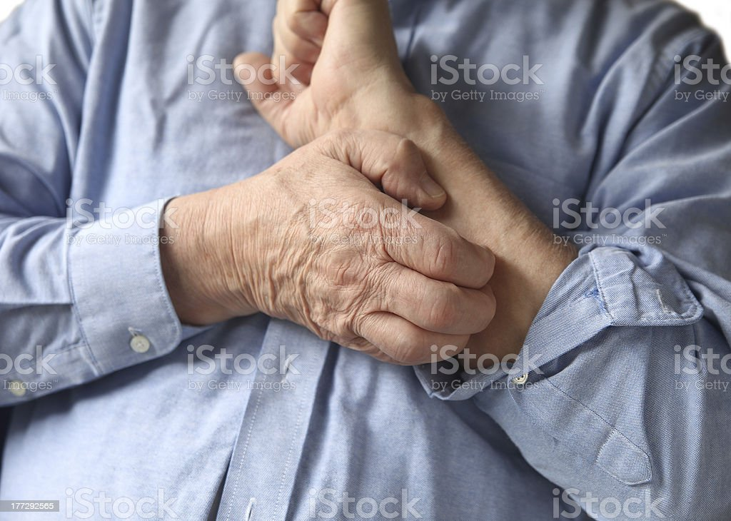 businessman with an itchy arm stock photo