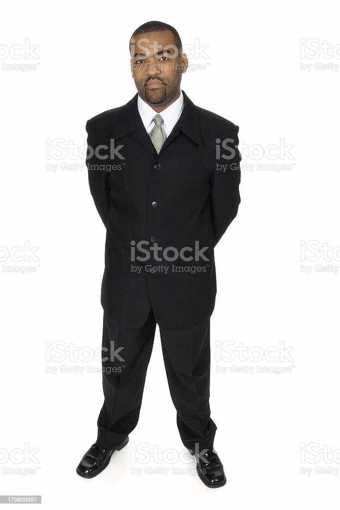 Businessman With Arms Behind His Back stock photo