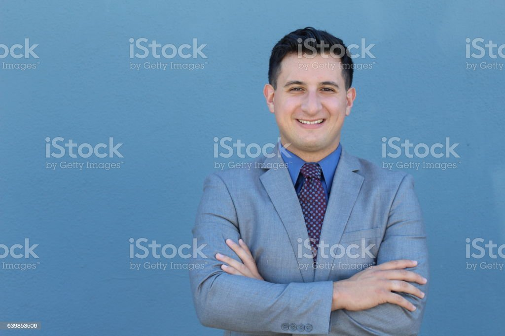 Businessman with arms crossed smiling stock photo
