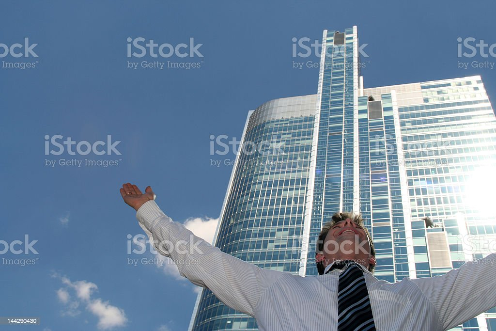 Businessman with arms outstretched royalty-free stock photo