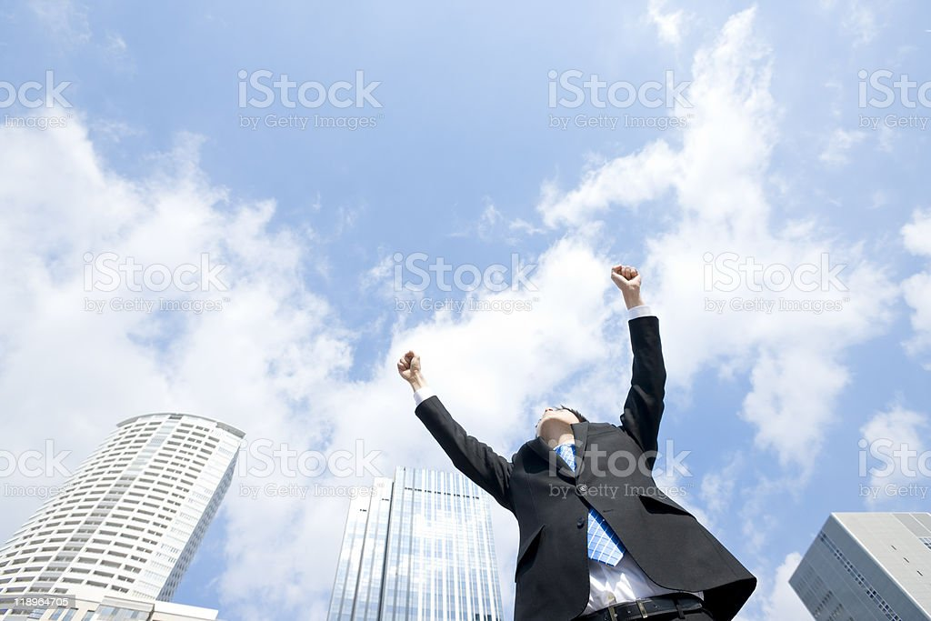 Businessman with arms raised towards the sky royalty-free stock photo