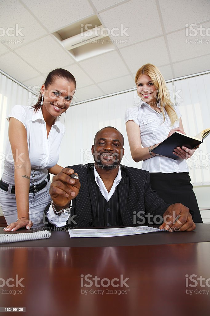 Businessman with assistants stock photo