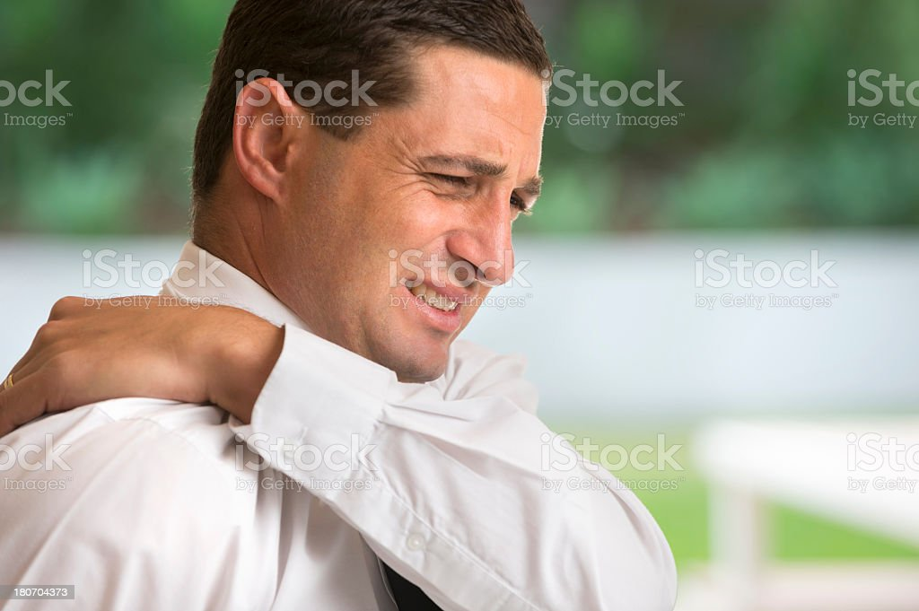 Businessman with back and neck pain royalty-free stock photo