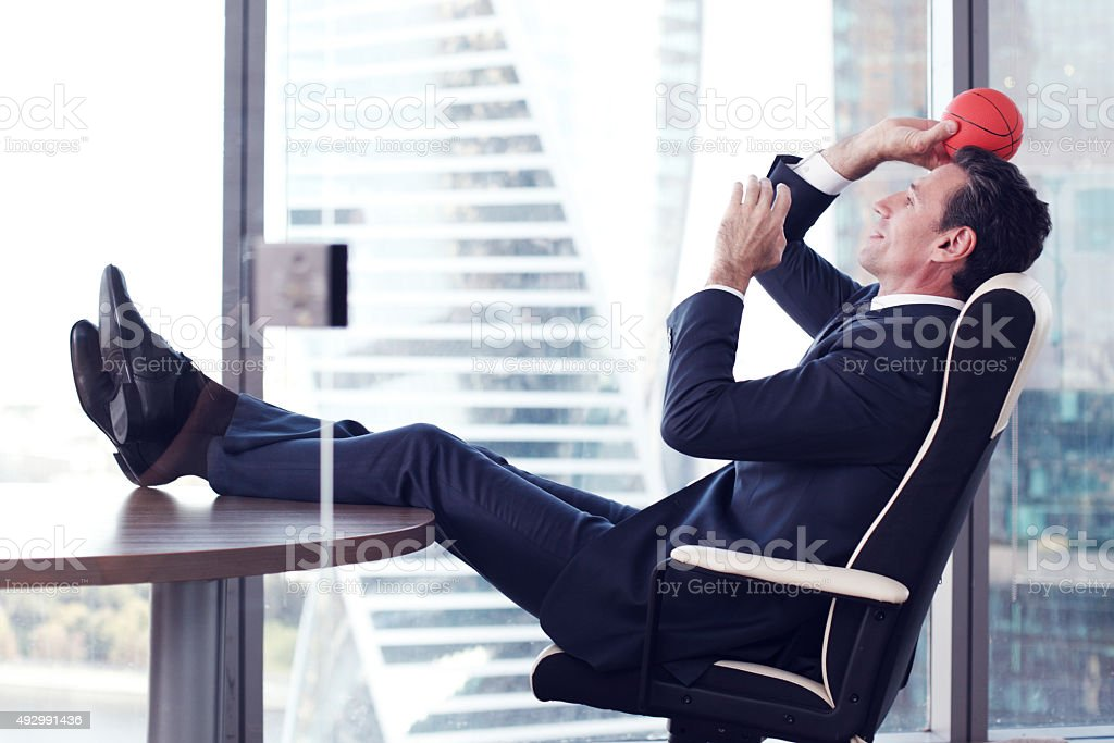 Businessman with basketball stock photo