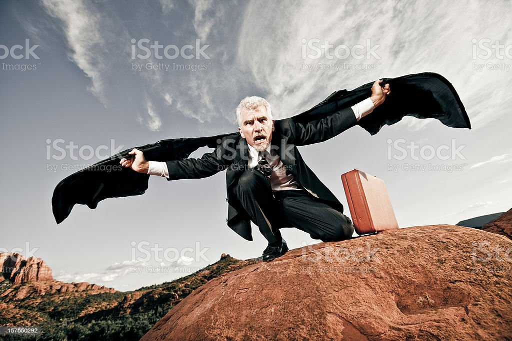 Businessman with bat wings stock photo