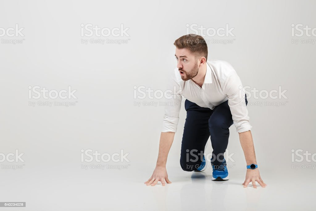 businessman with beard in white shirt on position of start stock photo