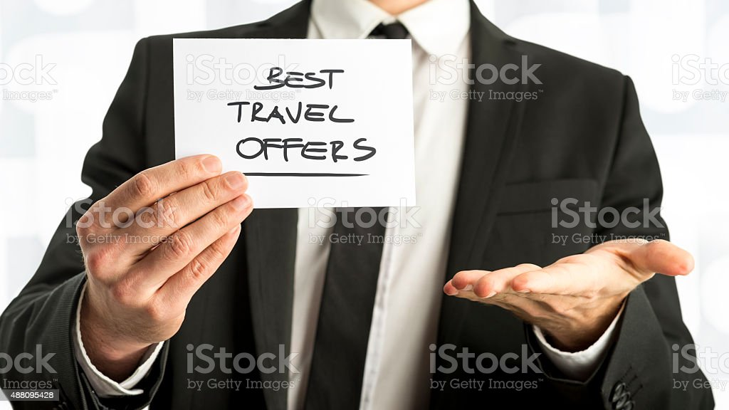 Businessman with Best Travel Offers Texts on Paper stock photo