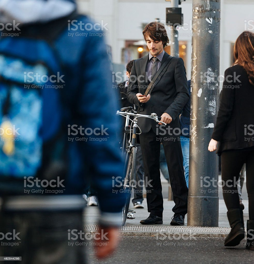 Businessman with Bicycle and smartphone royalty-free stock photo