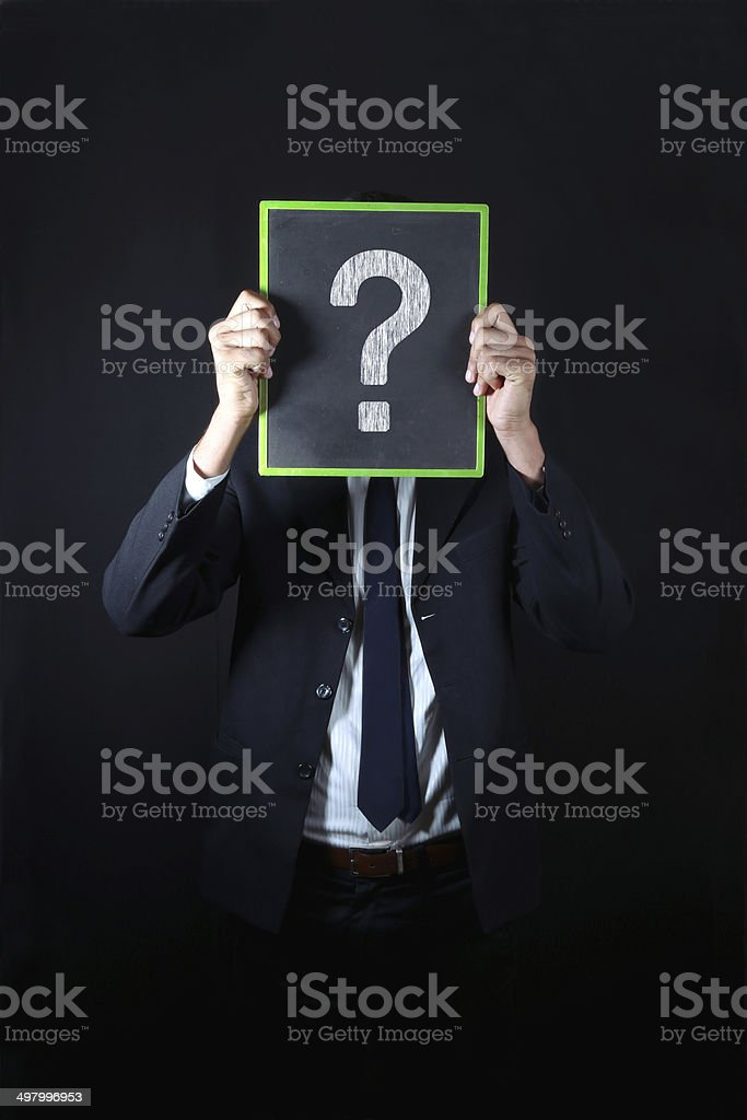Businessman with big question mark royalty-free stock photo