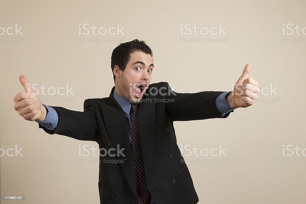 Businessman with big thumbs up stock photo