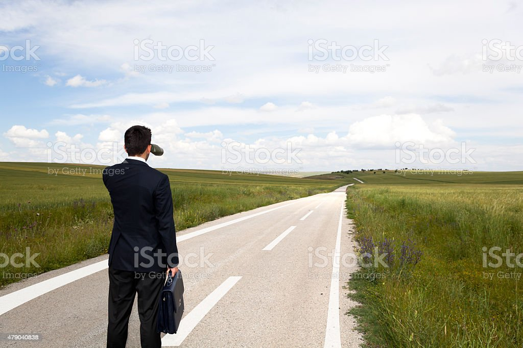 Businessman with binocular on travel stock photo