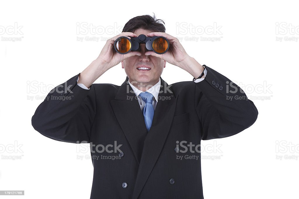 Businessman with binoculars looking to the future royalty-free stock photo