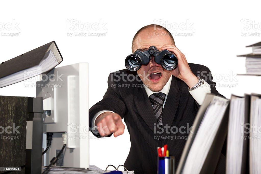 businessman with binoculars stock photo