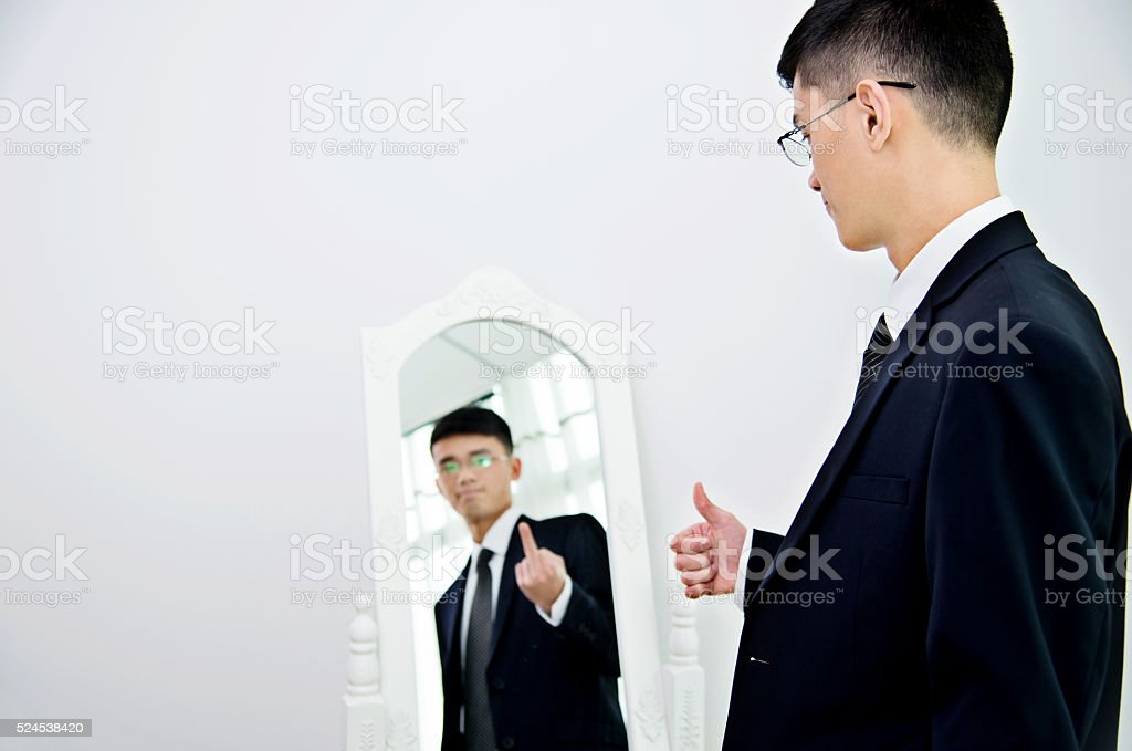 Businessman with bipolar disorder stock photo