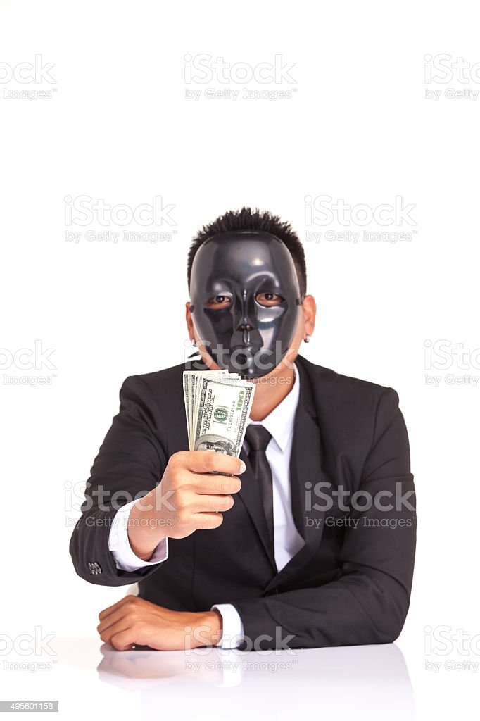 businessman with black glossy fancy mask holding bank note stock photo